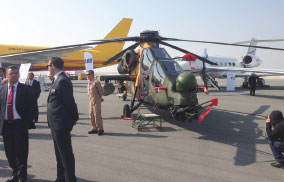 TAI's T129 ATAK Helicopter Performed Flight Demonstration at BIAS 2014